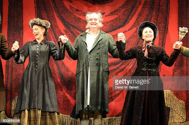 Amelia Bullmore Jim Broadbent and Samantha Spiro bow at the curtain call during the press night performance of 'A Christmas Carol' at the Noel Coward...