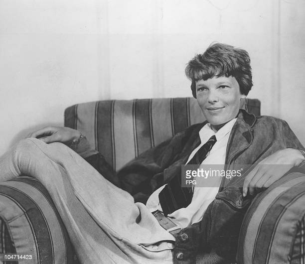 Amelia Earhart American aviator wearing a shirt and tie while reclining in an armchair circa 1935