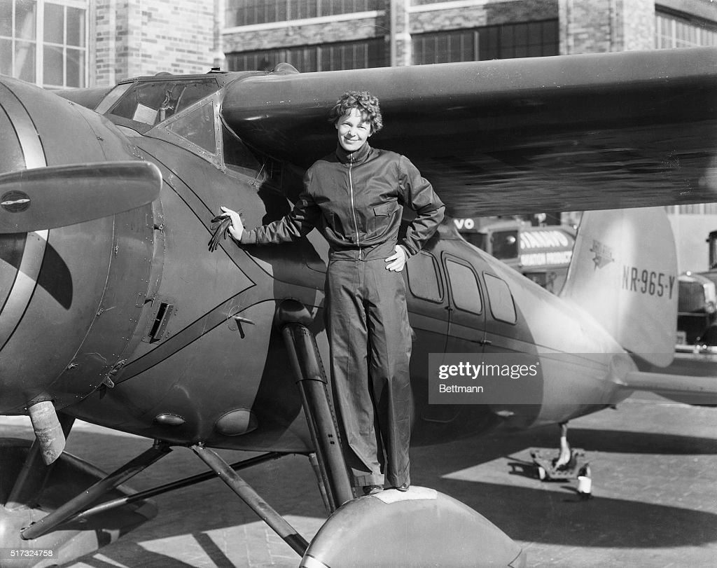 Amelia Earhart Next to Aircraft : News Photo