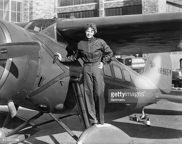 Amelia Earhart American aviatrix first woman to cross Atlantic Photograph showing her with airplane