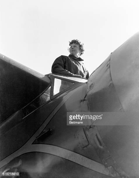 Amelia Earhart American aviatrix first woman to cross Atlantic Ocean in airplane Photograph showing her from below in airplane Undated photograph