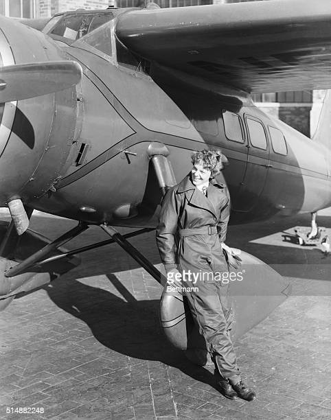 Amelia Earhart American aviatrix first woman to cross Atlantic Ocena in airplane Undated photograph showing her with airplane