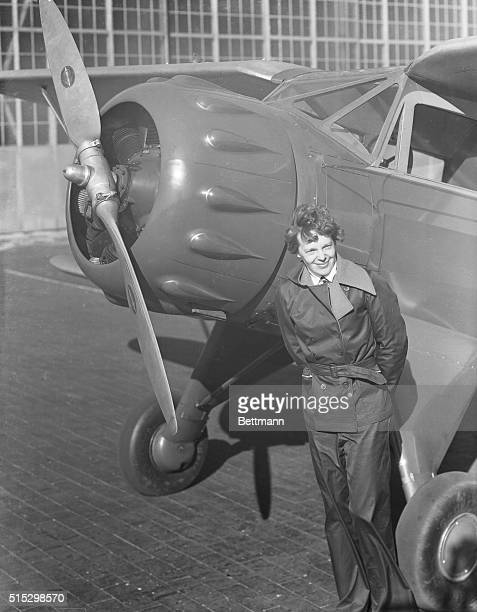 Amelia Earhart, , American aviatrix, first woman to cross the Atlantic Ocean in an airplane. She stands next to the propeller of her plane. Undated...