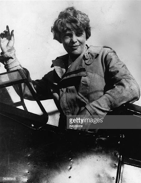 Amelia Earhart an American pilot the first woman to fly the Atlantic seen here in the cockpit of her plane
