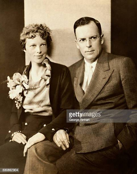 Amelia Earhart and her husband, George Palmer Putnam, are shown seated.