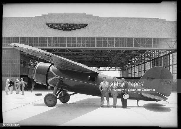 Amelia Earhart and Two Men in front of her Lockheed Vega 1932