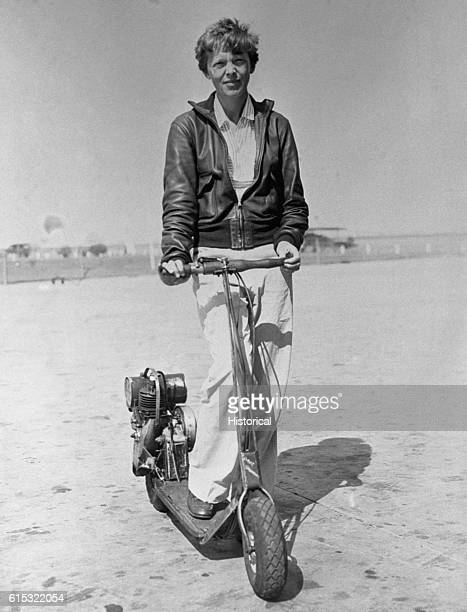 Amelia Earhart Holding Motorized Scooter