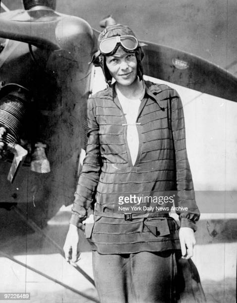Amelia Earhart in front of plane