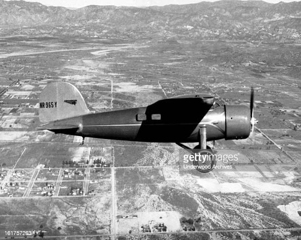 Amelia Earhart in her Lockheed Vega plane flying over Burbank Burbank California 1934 She later flew the same plane from Honolulu to Oakland