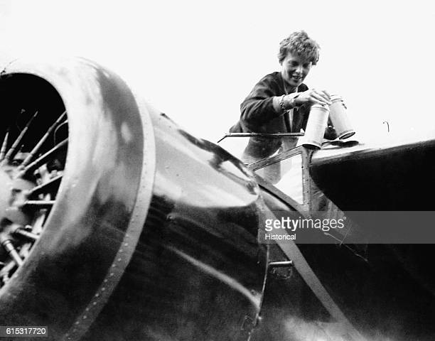 Amelia Earhart in the cockpit of her plane after flying across the Atlantic solo