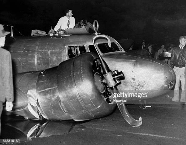 Amelia Earhart inspects her damaged Lockheed Electra 10E at Luke Field on Ford Island in Pearl Harbor