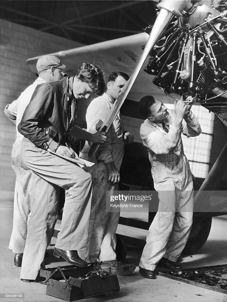 Amelia Earhart prepares her plane for her flight between the various islands of The American Pacific, Wheeler Fields, Hawaii, April 1935.