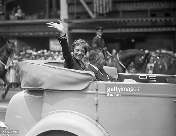 Amelia Earhart Putnam first woman to fly the Atlantic waves a cheery acknowledgement of the ovation of the throngs who lined Broadway today as she...