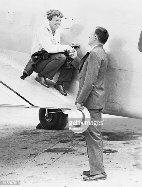 Amelia Earhart saying goodbye to her husband George P Putnam at Miami Florida June 1st just before she took off with Captain Fred Noonan for Puerto...