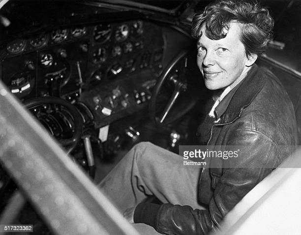 Amelia Earhart smiles as she sits clad in a leather aviator's jacket in the cockpit of a small airplane One of the world's most famous aviators...