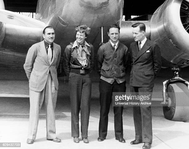 Amelia Earhart Standing With Paul Maas Harry Manning and Fred Noonan in Front of her Lockheed Electra Airplane Honolulu Airport Hawaii March 20 1937