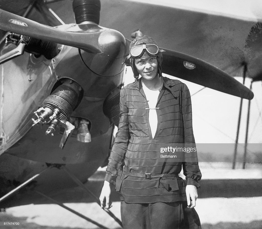 Amelia Earhart Stands In Front of Plane : News Photo