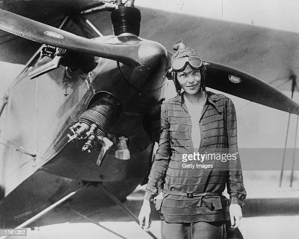 Amelia Earhart stands June 14 1928 in front of her biplane called 'Friendship' in Newfoundland Carlene Mendieta who is trying to recreate Earhart's...