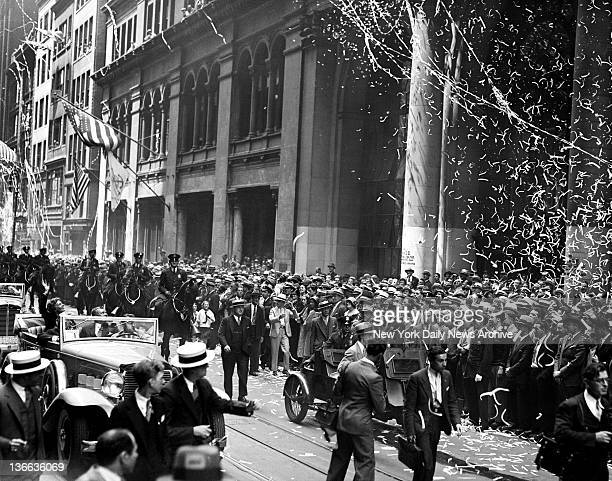 Amelia Earhart Ticker Tape Parade EARHART Amelia Earhart waves from her car as ticker tape whitens crowd in Broadway and in response to crowd at...