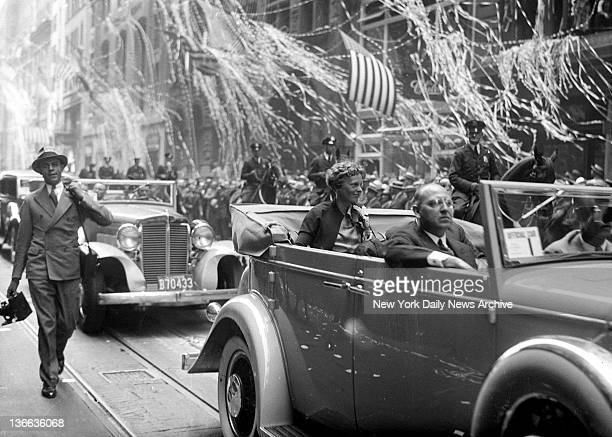Amelia Earhart Ticker Tape Parade The background is white with ticker tape as Amelia Earhart is borne up Broadway in her triumphal procession from...