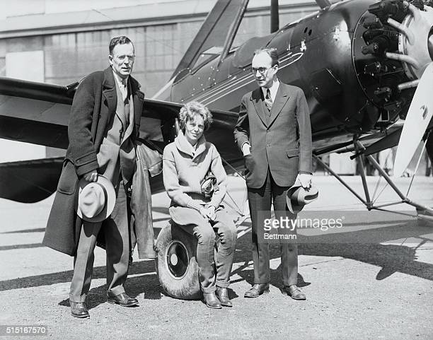 Amelia Earhart transatlantic aviatrix with her husband George Palmer Putnam Jr the publisher left and Harold Pitcairn the airplane designer before...