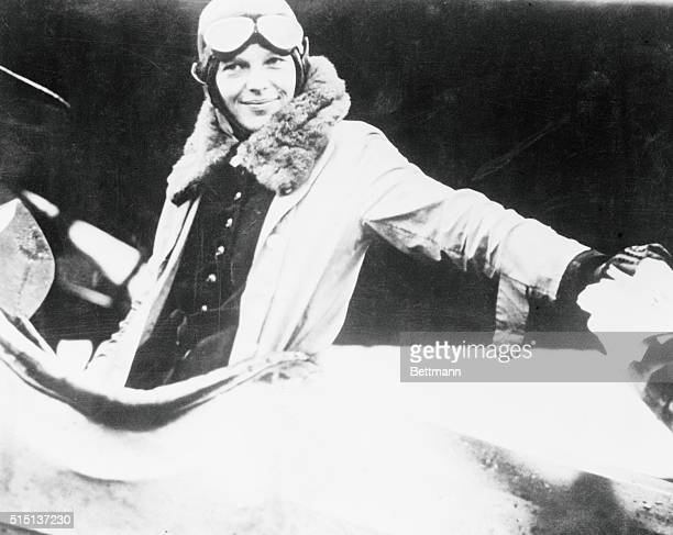 Amelia Earhart who plans to hop to England with Wilmer Stultz Amelia seated in aircraft