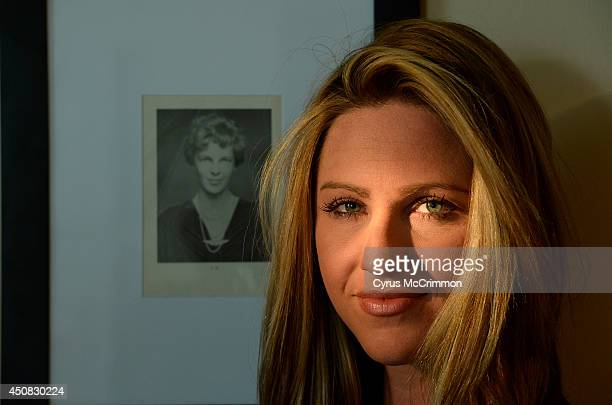 Amelia Earhart with a portrait of her namesake at her Denver home on Tuesday June 17 2014 Earhart has left her television job at KUSA to recreate the...