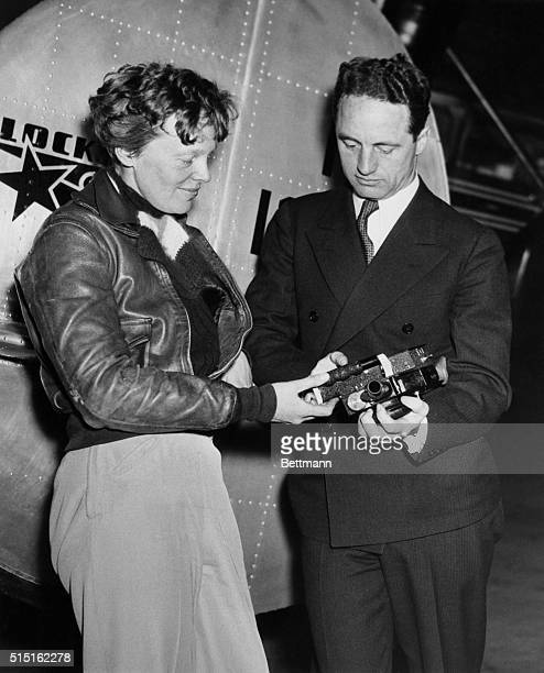 Amelia Earhart with her second navigator Harry Manning who along with Fred Noonan was scheduled to participate in Earhart's roundtheworld flight...