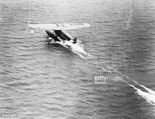 Amelia Earhart's transatlantic plane, Friendship, is seen here taking off from Burry Point, Wales, for its final destination, Southampton. |...