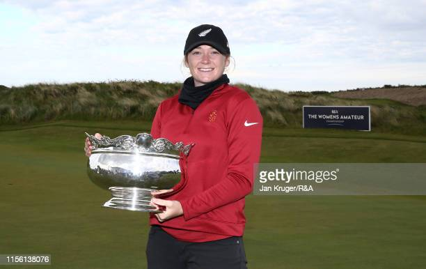 Amelia Garvey of New Zealand poses with the runners up trophy following defeat during the final match on day five of the RA Womens Amateur...