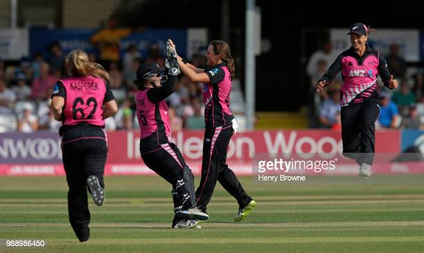 Amelia Kerr celebrates with team mates after taking the wicket of Sarah Taylor of England during the International T20 TriSeries Final between...