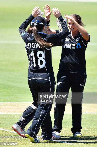 Amelia Kerr of New Zealand celebrates after taking the wicket of Beth Mooney of Australia during game two of the One Day International Series between...