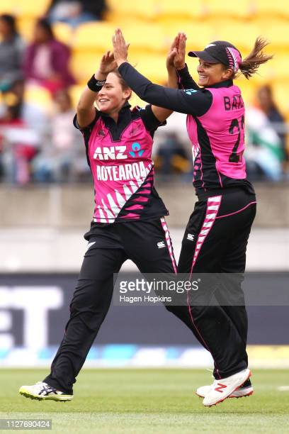 Amelia Kerr of New Zealand celebrates with Suzie Bates after taking the wicket of Dayalan Hemalatha of India during game one of the International T20...
