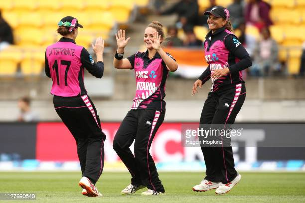 Amelia Kerr of New Zealand celebrates with Suzie Bates and Amy Satterthwaite after taking the wicket of Dayalan Hemalatha of India during game one of...