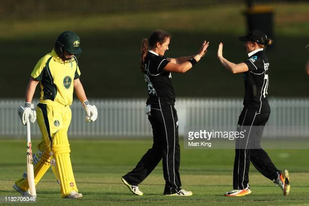 Amelia Kerr of New Zealand celebrates with team mates after taking the wicket of Josie Dooley of the GovernorGeneral's XI during the...