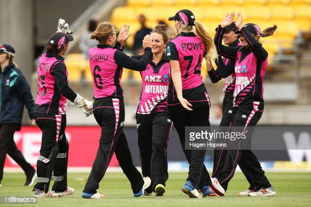 Amelia Kerr of New Zealand celebrates with teammates after taking the wicket of Dayalan Hemalatha of India during game one of the International T20...