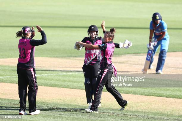 Amelia Kerr of the White Ferns celebrates the wicket of Harmanpreet Kaur of India during the Women's International T20 Game 3 between New Zealand and...