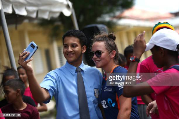 Amelia Kerr poses with local school children during a Schools and Community Outreach Program session at Diamond Secondary School on November 10 2018...