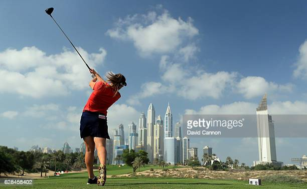 Amelia Lewis of the United States plays her tee shot on the eighth hole during the completion of the first round of the 2016 Omega Dubai Ladies...