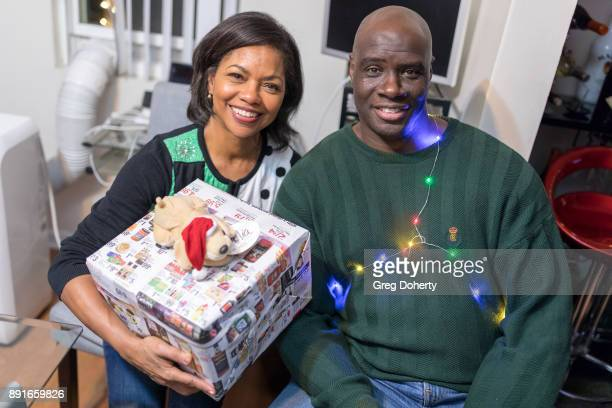 Amelia Marshall and Isaac C Singleton Jr attend The Bay Ugly Sweater And Secret Santa Christmas Party at Private Residence on December 12 2017 in Los...