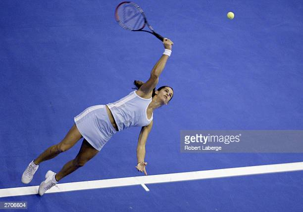 Amelia Mauresmo serves to Elena Dementieva during a round robin match won by Mauresmo 6-3, 6-2 for the 2003 Bank of America WTA Tour Championships on...