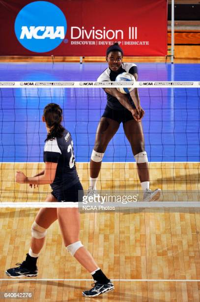 Amelia McCall of Emory University hits a bump against Calvin College during the Division III Women's Volleyball Championship held at the Washington...