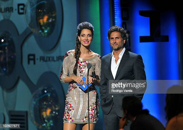 Amelia Vega and Eugenio Siller speak onstage at the Univision Premios Juventud Awards at BankUnited Center on July 15 2010 in Miami Florida
