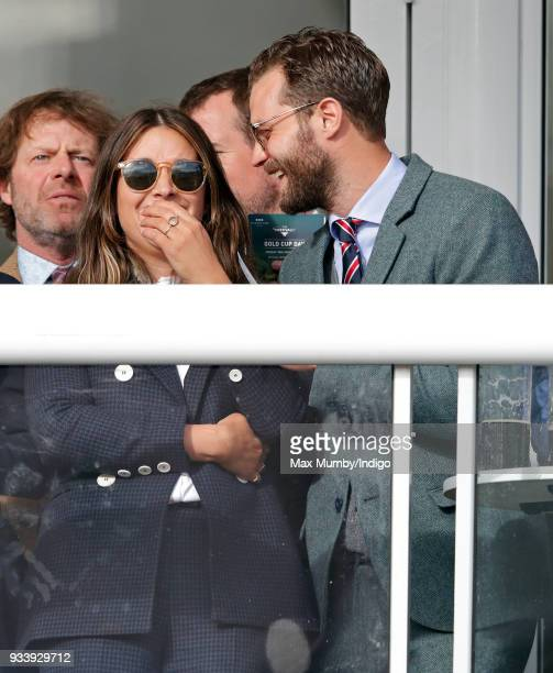 Amelia Warner and Jamie Dornan attend day 4 'Gold Cup Day' of the Cheltenham Festival at Cheltenham Racecourse on March 16 2018 in Cheltenham England