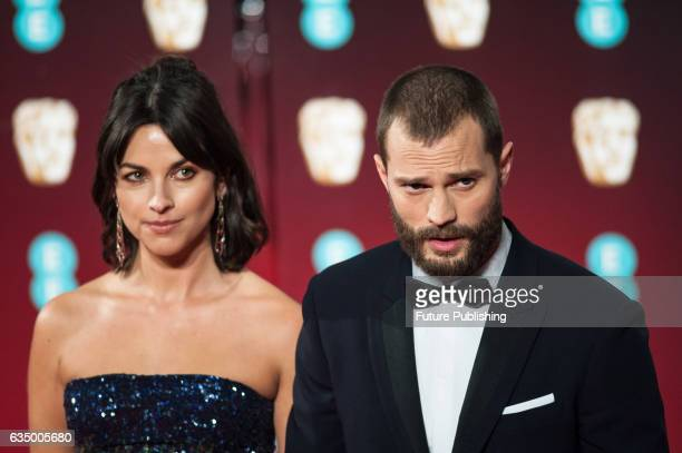 Amelia Warner and Jamie Dornan attend the 70th British Academy Film Awards ceremony at the Royal Albert Hall on February 12 2017 in London England...