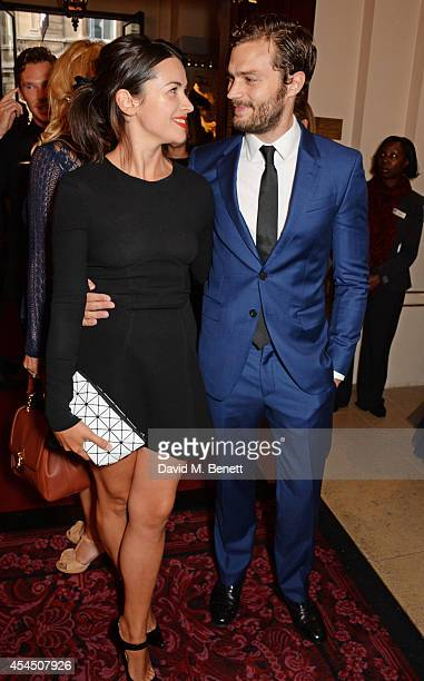 Amelia Warner and Jamie Dornan attend the GQ Men Of The Year awards in association with Hugo Boss at The Royal Opera House on September 2 2014 in...
