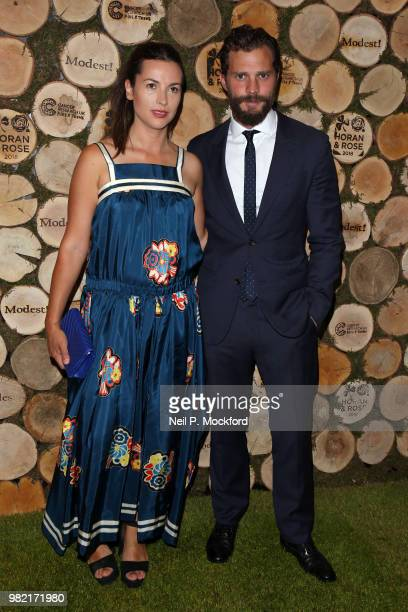 Amelia Warner and Jamie Dornan attend the Horan And Rose Charity Event held at The Grove on June 23 2018 in Watford England