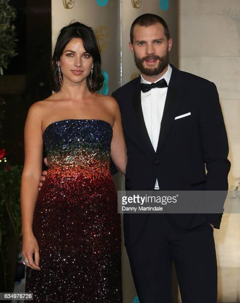 Amelia Warner and Jamie Dornan attends the official after party for the 70th EE British Academy Film Awards at The Grosvenor House Hotel on February...
