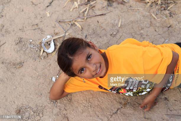 Amelia Whyman poses on the dry bed of the Darling -Barka river on March 04, 2019 in Wilcannia, Australia. The Barkandji people - meaning the river...