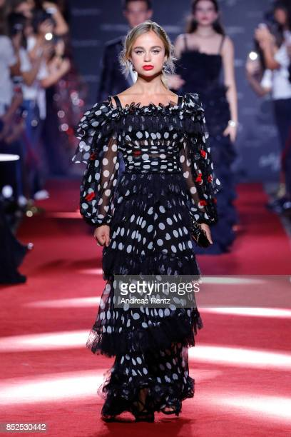 Amelia Windsor walks the runway at the Dolce Gabbana secret show during Milan Fashion Week Spring/Summer 2018 at Bar Martini on September 23 2017 in...